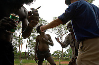 Men hang out on Tiwi Island--aboriginals and whites togther for a ritual and ceremony.