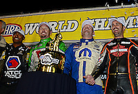Nov. 11, 2012; Pomona, CA, USA: NHRA top fuel champions (from left) Antron Brown , Jack Beckman , Allen Johnson and Eddie Krawiec celebrate after winning the 2012 championship during the Auto Club Finals at at Auto Club Raceway at Pomona. Mandatory Credit: Mark J. Rebilas-