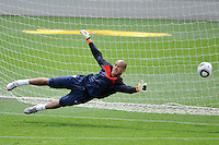 Goalkeeper Tim Howard dives for a ball during the U. S. men's national team practice at Princeton University in Princeton, NJ, on May 22, 2010.