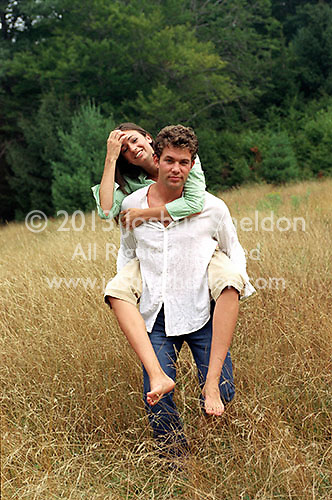 Young man giving a piggy back ride<br />