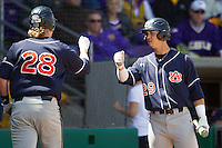 Auburn Tigers shortstop Dan Glevenyak #29 greets teammate Garrett Cooper #28 after he scored against the LSU Tigers in the NCAA baseball game on March 24, 2013 at Alex Box Stadium in Baton Rouge, Louisiana. LSU defeated Auburn 5-1. (Andrew Woolley/Four Seam Images).