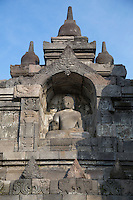 Borobudur, Java, Indonesia.  Buddha Statue Showing the Vitarka Mudra, the gesture used when giving a lecture or a speech.