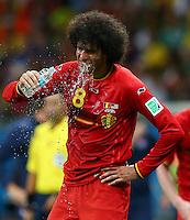 Marouane Fellaini of Belgium pours water over his face