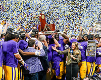ATLANTA, GA - DECEMBER 7: head coach Ed Orgeron of the LSU Tigers celebrates after being presented with the SEC Championship trophy during a game between Georgia Bulldogs and LSU Tigers at Mercedes Benz Stadium on December 7, 2019 in Atlanta, Georgia.