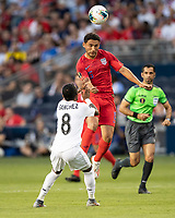 KANSAS CITY, KS - JUNE 26: Cristian Roldan #15 heads the ball as Marcos Sanchez #8 looks on during a game between Panama and USMNT at Children's Mercy Park on June 26, 2019 in Kansas City, Kansas.