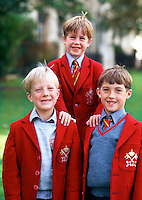 Portrait of smiling, young British Public School boys in traditional uniform attire. York, England.