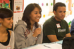 Panel of college students presenting to group of Headstart graduates about college application process and opportunities that await them. All participants are Headstart program graduates