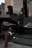 """New York, New York<br /> November 15, 2011<br /> <br /> After the police clear Zuccotti Park many of the evicted and exhausted """"Occupy Wall Street"""" protesters, reconvened in Foley Square.<br /> <br /> The protesters then marched to Juan Pablo Duarte Square at Canal and 6th Ave and final back to Zuccotti Park to wait a court order to reenter the park."""