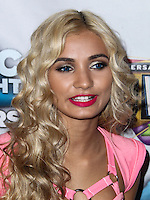 """UNIVERSAL CITY, CA, USA - APRIL 19: Singer Pia Mia poses backstage at the Pia Mia And Dev Concert As Part Of The """"Spring Concert Series"""" Presented By AMP 97.1 Radio held at 5 Towers Outdoor Concert Arena at Universal CityWalk on April 19, 2014 in Universal City, California, United States. (Photo by Xavier Collin/Celebrity Monitor)"""