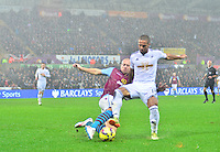 Pictured: Friday 26 December 2014<br /> Re: Premier League, Swansea City FC v Aston Villa at the Liberty Stadium, Swansea, south Wales, UK.<br /> <br /> Swansea's Wayne Routledge on the ball