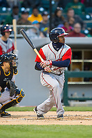 Jose Constanza (12) of the Gwinnett Braves follows through on his swing against the Charlotte Knights at BB&T Ballpark on April 16, 2014 in Charlotte, North Carolina.  The Braves defeated the Knights 7-2.  (Brian Westerholt/Four Seam Images)