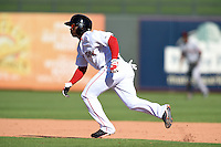 Surprise Saguaros outfielder Rusney Castillo (38) during an Arizona Fall League game against the Scottsdale Scorpions on October 11, 2014 at Surprise Stadium in Surprise, Arizona.  Scottsdale defeated Surprise 7-6.  (Mike Janes/Four Seam Images)