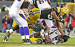 Green Bay Packers linebacker Desmond Bishop tackles Minnesota Vikings quarterback Brett Favre during the 4th quarter of the game at Lambeau Field in Green Bay, Wis., on Oct. 24, 2010.