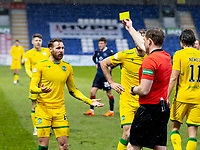 13th March 2021; Global Energy Stadium, Dingwall, Highland, Scotland; Scottish Premiership Football, Ross County versus Hibernian; Martin Boyle of Hibernian is shown the yellow card for his challenge on Leo Fuhr Hjelde of Ross County