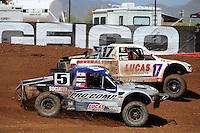 Apr 17, 2011; Surprise, AZ USA; LOORRS driver Travis Coyne (5) races alongside Carl Renezeder (17) during round 4 at Speedworld Off Road Park. Mandatory Credit: Mark J. Rebilas-