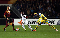 Swansea, UK. Thursday 20 February 2014<br /> Pictured: Nathan Dyer of Swansea (C) avoids a tackle by Blerim Dzemaili of Napoli (R)<br /> Re: UEFA Europa League, Swansea City FC v SSC Napoli at the Liberty Stadium, south Wales, UK