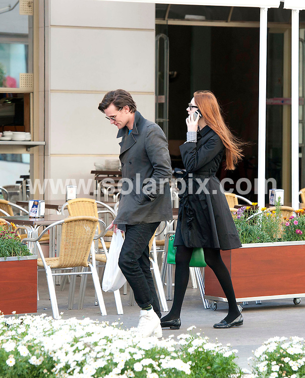 """**ALL ROUND EXCLUSIVE PICTURES FROM SOLARPIX.COM** .**UK MAGAZINES**.**DOUBLE SPACE RATES APPLY**MINIMUM PUBLICATION FEE £150.00 PER PICTURE**                                                                                                                                             **WORLDWIDE SYNDICATION RIGHTS EXCEPT SPAIN - NO SYNDICATION IN SPAIN**                                                                                  Dr Who filming in Spain..Dr Who actor Matt Smith and Karen Gillan who plays his companion Amy Pond are currently in Almeria, Spain, filming an episode called """"Gun Slingers""""..Matt & Karen were spotted out and about in the city of Almeria on their day off from filming. They visited a local cafe then took a stroll to Burger King. They were both busy on their mobile phones.                                                                         This pic:    Matt Smith and Karen Gillan                                                                                     JOB REF:   14555   RAP       DATE:  12.03.12                                                          **MUST CREDIT SOLARPIX.COM OR DOUBLE FEE WILL BE CHARGED**                                                                      **MUST AGREE FEE BEFORE ONLINE USAGE**                               **CALL US ON: +34 952 811 768 or LOW RATE FROM UK 0844 617 7637**"""