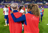 ORLANDO, FL - JANUARY 22: Megan Rapinoe #15 is hugged by Catarina Macario #29 of the USWNT after a game between Colombia and USWNT at Exploria stadium on January 22, 2021 in Orlando, Florida.