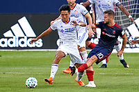 CHICAGO, UNITED STATES - AUGUST 25: Yuya Kubo #7 of FC Cincinnati battles with Alvaro Medran #10 of Chicago Fire for the ball during a game between FC Cincinnati and Chicago Fire at Soldier Field on August 25, 2020 in Chicago, Illinois.