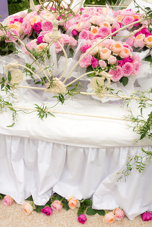 Actual bed adorned with roses for a play on words joke, bed of roses, wedding night