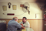 Two men chatting friend catching up on life in a cafe restaurant Buenos Aires  Argentina South America. 2000s 2002
