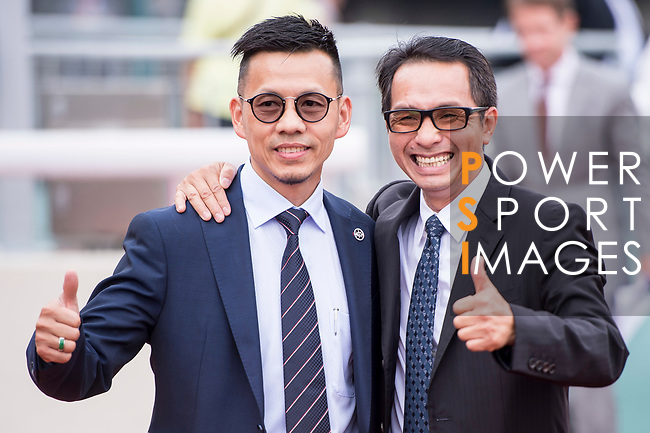 Trainer Frankie Lor Fu-chuen (l) celebrates for horse Yourthewonforme's winning the Race 5, Tim Mei Handicap, at the Sha Tin Racecourse on 03 September 2017 in Hong Kong, China. Photo by Marcio Rodrigo Machado / Power Sport Images