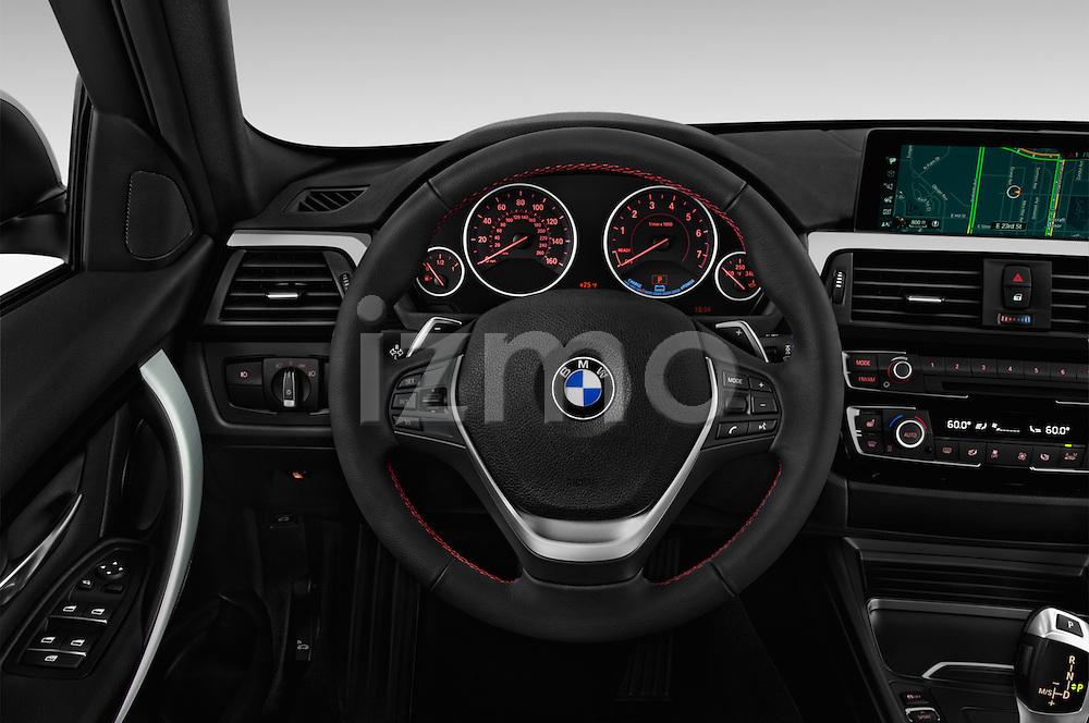 Car pictures of steering wheel view of a 2018 BMW 3-Series 330e-iPerformance 4 Door Sedan Steering Wheel