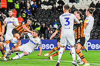 Hull City's defender Reece Burke (5) shot is blocked in a crowded Leeds United box during the Sky Bet Championship match between Hull City and Leeds United at the KC Stadium, Kingston upon Hull, England on 2 October 2018. Photo by Stephen Buckley/PRiME Media Images.