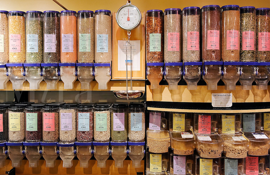 Whole foods and grain dispensers in a health food store.