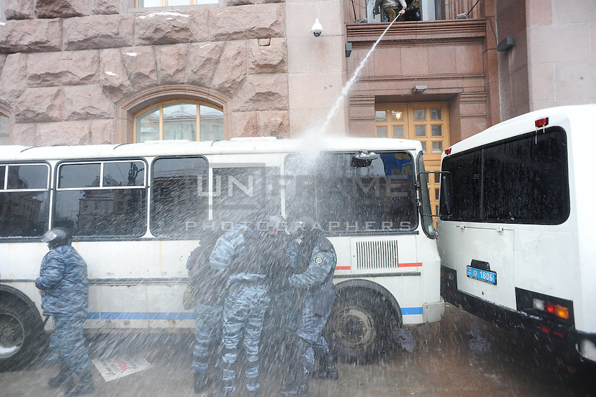 Protesters use fire hydrants to repel  Berkut special police forces from town hall. Kiev Ukraine.   The temperature on the street is 12 degrees C. below zero<br /> <br /> Protesters did not give up after the faint  attempt of evacuation performed by the police of the night before. Despite the adverse weather conditions,  they restored and rebuilt the complex structures of the  barricades under the snow in Maidan square. Kiev,  Ukraine.