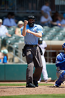 Umpire Nolan Earley calls a strike during a South Atlantic League game between the Lexington Legends and Augusta GreenJackets on April 30, 2019 at SRP Park in Augusta, Georgia.  Augusta defeated Lexington 5-1.  (Mike Janes/Four Seam Images)