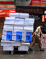 Computers belong to the chinese manufacturer King Ge are moving along a street in Guangzhou, China. .