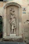 Boulbon south of France village street St Christopher 14th-century statue statue plaque fixed to a village wall  2016.