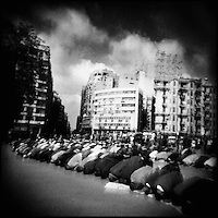 Egypt/Cairo/Tahrir square/Feb 2011. Thousands of Egyptian protesters pray at Tahrir Square.The 2011 Egyptian revolution  took place following a popular uprising that began on Tuesday, 25 January 2011. The uprising was mainly a campaign of non-violent civil resistance, which featured a series of demonstrations, marches, acts of civil disobedience, and labour strikes. Millions of protesters from a variety of socio-economic and religious backgrounds demanded the overthrow of the regime of Egyptian President Hosni Mubarak. .Giorgos Moutafis