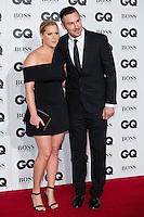 (L-R) Amy Schumer and Ben Hanisch arrive for the GQ Men Of The Year Awards 2016 at the Tate Modern, London