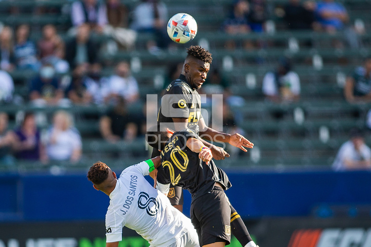 CARSON, CA - MAY 8: Jose Cifuentes #11  of LAFC heads a ball during a game between Los Angeles FC and Los Angeles Galaxy at Dignity Health Sports Park on May 8, 2021 in Carson, California.