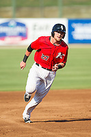 Trey Michalczewski (27) of the Kannapolis Intimidators hustles towards third base against the Augusta GreenJackets at CMC-NorthEast Stadium on August 3, 2014 in Kannapolis, North Carolina.  The Intimidators defeated the GreenJackets 10-5. (Brian Westerholt/Four Seam Images)