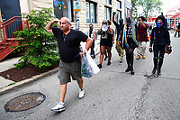 Protesters march through East Liberty to demonstrate Pittsburgh Police reoccupying Zone 5 police station on Monday July 13, 2020 in Pittsburgh, Pennsylvania. (Photo by Jared Wickerham/Pittsburgh City Paper)