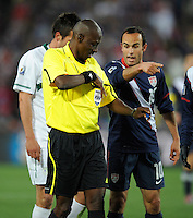 Landon Donovan (10) of USA helps referee Koman Coulibaly identify the yellow card recipient. USA tied Slovenia 2-2 in the 2010 FIFA World Cup at Ellis Park in Johannesburg, South Africa on June 18th, 2010.