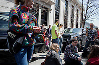 People gather around radios and cars outside the Cathedral of the Holy Cross to hear a broadcast of an interfaith gathering that included President Obama on April 18, 2013, 3 days after the bombings at the 2013 Boston Marathon.