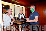 John C O'Shea delivers Denis O'Leary and Ossi Fritsche their order in Jack C's pub Killarney on Monday after reopening