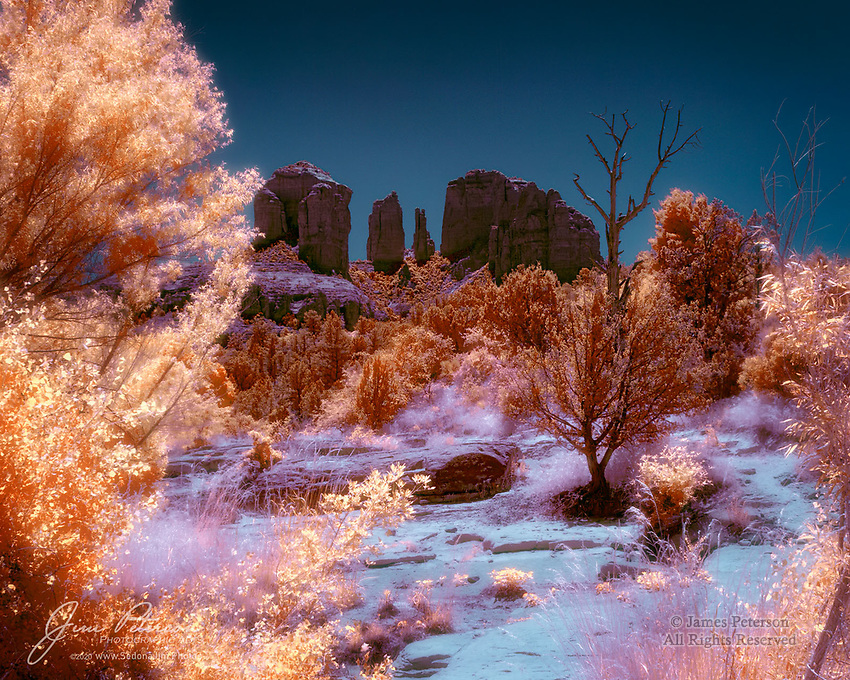 Desert Cathedral (Infrared).  Cathedral Rock, probably Sedona's most iconic and most photographed sandstone formation, takes on a slightly Gothic look if you regard it from the right direction - and assuming you have infrared eyes.  This is the view from near Red Rock Crossing, a favorite swimming hole on Oak Creek in Arizona's Coconino National Forest.<br /> <br /> Image ©2020 James D. Peterson