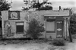 Disused old adobe building, a trading post with native American indigenous Indian painting on the exterior walls. Sweetwater, Texas USA 1999 and old disused building. 1990s USA