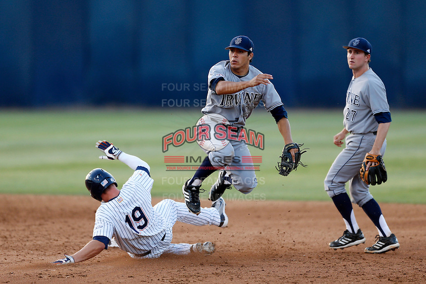 Chris Rabago #22 of the UC Irvine Anteaters throws to first base after  forcing out Matt Chapman #19 of the Cal State Fullerton Titans at second base during a game at Goodwin Field on May 18, 2013 in Fullerton, California. Fullerton defeated UC Irvine, 3-2. (Larry Goren/Four Seam Images)