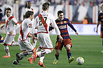 Rayo Vallecano's Manuel Iturra (l) and Diego LLorente (c) and FC Barcelona's Leo Messi during La Liga match. March 3,2016. (ALTERPHOTOS/Acero)