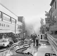 Incendie sur la rue st-Joseph, dans le quartier st-Roch, Quebec, Juillet 1961<br /> <br /> PHOTO : Agence Quebec Presse