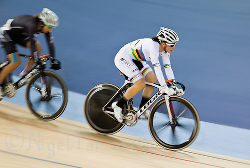 18 FEB 2012 - LONDON, GBR - Canada's Tara Whitten (CAN) (in white) leads New Zealand's Joanne Kiesanowski (NZL) during the Women's Omnium Elimination Race at the UCI Track Cycling World Cup, and London Prepares test event for the 2012 Olympic Games, in the Olympic Park Velodrome in Stratford, London, Great Britain .(PHOTO (C) 2012 NIGEL FARROW)