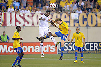 Edson Buddle (14) of the United States and Lucas (5) of Brazil go up for a header. The men's national team of Brazil (BRA) defeated the United States (USA) 2-0 during an international friendly at the New Meadowlands Stadium in East Rutherford, NJ, on August 10, 2010.