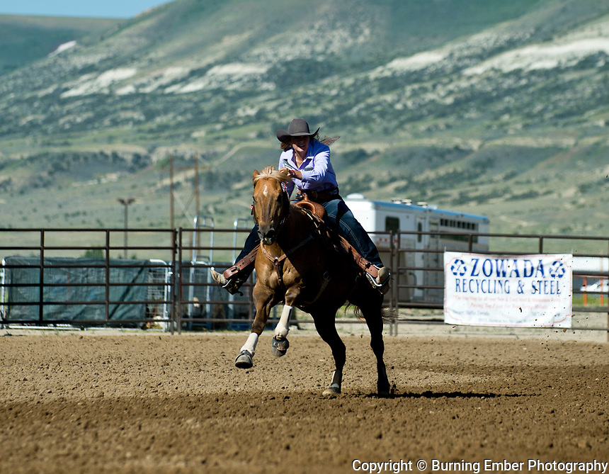 Sheyenne Jacobson in the Pole Bending Thursday 1st round event at the Wyoming State High School Finals Rodeo in Rock Springs Wyoming.  Photo by Josh Homer/Burning Ember Photography.  Photo credit must be given on all uses.