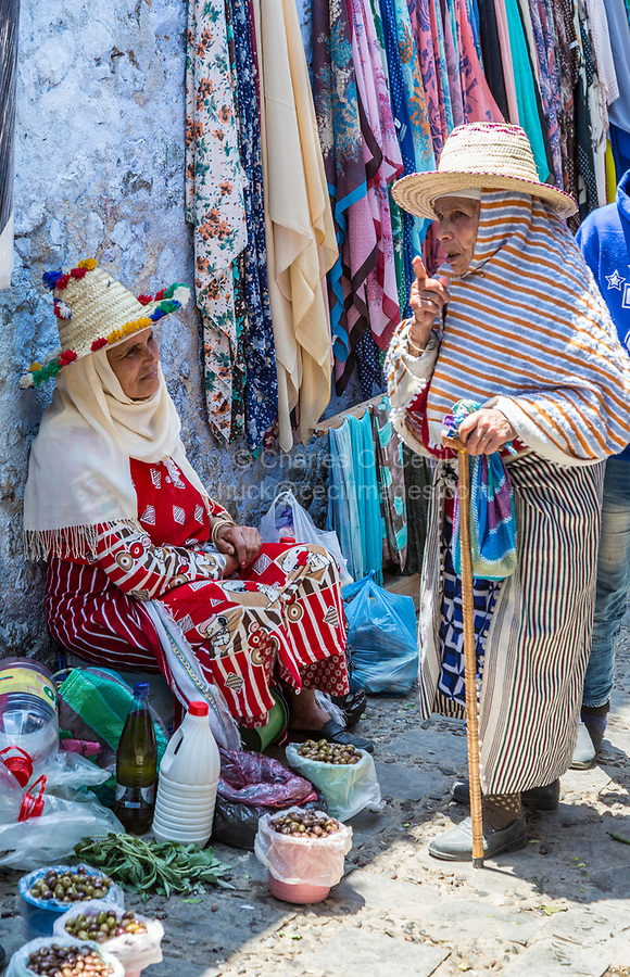 Chefchaouen, Morocco.  Two Berber Women in Traditional Dress Talking in the Market.